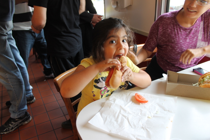 Cute girl enjoying the best hot dog in la