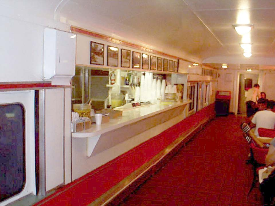 old school photo of the inside of carneys carney train